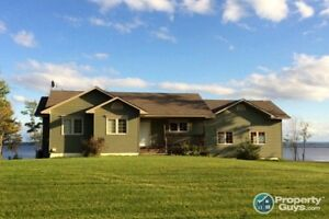 Bungalow waterfront on Grand Lake. Close to Minto & Fredericton.