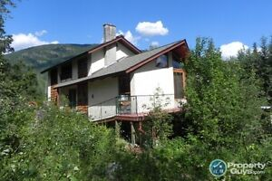 Spacious home and out-buildings on 14.2 acres Salmo ID 197306