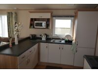static caravan, at devon cliffs £22,950 ono, c/h d/g fully fitted out