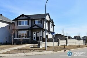 On a corner lot, open concept, 3 bed income suite!