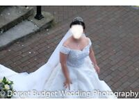 Be a Princess on your wedding day! Beautiful heavily beaded bodiced wedding dress with long train