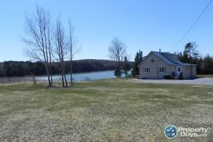 Very private country style 1.5 story home on 2.6 ac