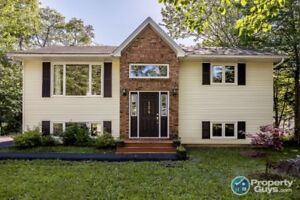 Spacious yet cozy split entry home on private, mature treed lot