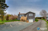 This fully renovated single family home sits on over an acre