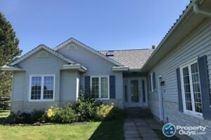 Close to amenities, 3 bed/2 bath on lovely landscaped lot
