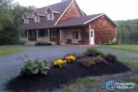 Waterfront  three story home w income potential