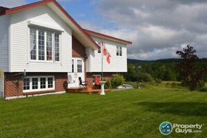 This home checks off all the boxes; privacy, view, pool!