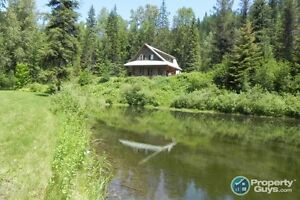 Home on 12.5 acres on the Salmo River ID 197304