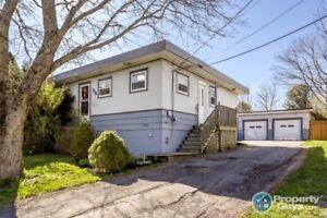 Amazing starter home, great location, triple detached garage!