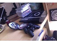 Used original PS3 with several games, 2 controllers, and all cables