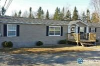 Great newer model mini home on 1.28 Acres in the East Side!