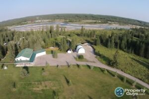 5 acres, large house, in town limits of Sundre