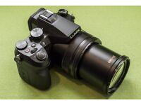 Panasonic DMC FZ 2000 new unopened. Filters and spare battteries