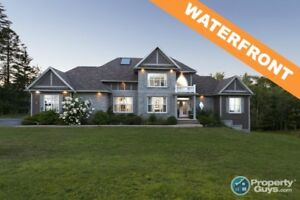 On 2.37 waterfront acres sits this AMAZING 4 bed/3.5 bath home