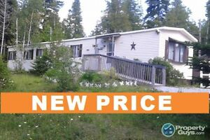 NEW PRICE! $54,900 for almost 2 Acres with mobile home!