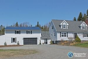 Modern Cape Cod with Attached 2 level Garage!