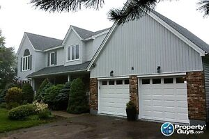 Overlooking the Kennebecasis River, over 3600 sqft of space!