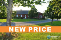 NEW PRICE!!  Waterfront property situated on 1.7 Acres!