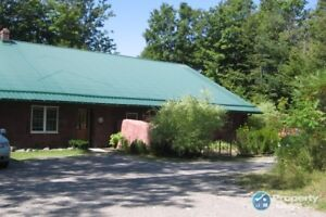 Amazing Strawbale Home on 22 Acres of Hardwood Forest