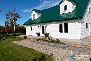 Beautiful country home on 10 acres plus shop - incredible price!