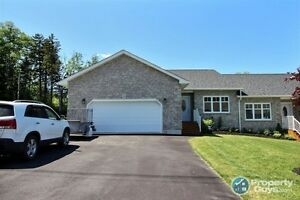 2 Br, 2 bath contemporary semi-detached home is a must see.