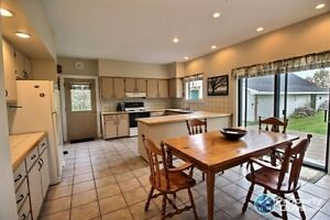 Country kitchen w lots of storage, natural light, large garage!