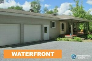 200ft of waterfrontage on Kingston Creek on 1.4 acres