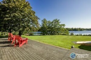 Over .5 ac, pristine waterfront bungalow, 4 bed/2 bath