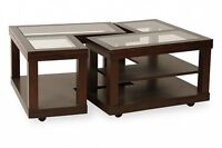 Glass top coffee table in medium wood frame.