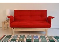 Double Bed size futon sofabed with arm rests and storage drawer.