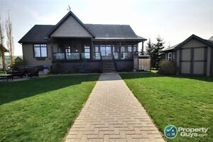 Waterfront living at its finest. 2589 sq ft high quality home