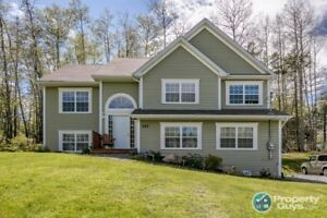 Stones throw away from Lost Creek Golf on 1.25 acres!