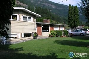 Custom built home in Slocan Park Sign #30998