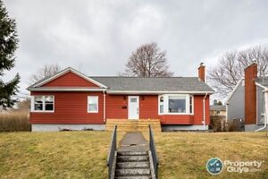 NEW LISTING! Renovated bungalow on large corner lot