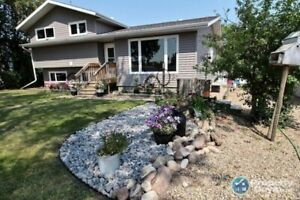 Wonderful family home in Viking is on 4 lots & has many upgrades