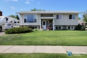 Open Concept Split Entry Home with 5 beds & 3 baths.