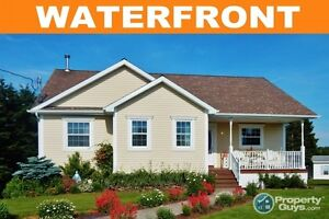 NEW LISTING! Gorgeous waterfront home on St. Andrews Channel.