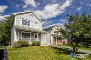 Fully finished 3 level home with private yard & close to schools