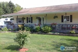 Waterfront custom built ranch-style bungalow on 1.26 ac