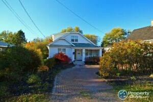 Renovated 1.5 storey home close to amenities & schools