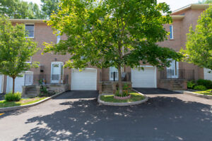 A Lovely Condominium Townhouse In Burlington That Is Close To Sc