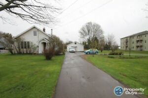 Prime Location! 2 separate parcels, 1 with 3 bed/3 bath home