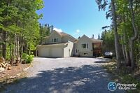 2.3 acres of privacy in the middle of town!