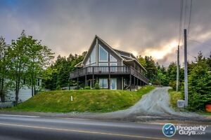 Remarkable A-frame chalet with complete wrap around deck