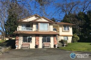 Well maintained 2,577 sf, 4 bed, 3 bath home with business space
