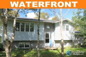 Spacious home on 4 acres & 300' waterfront access