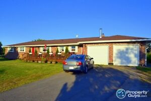Lovely 3 bedroom rancher is situated on 6.9 gently sloping acres