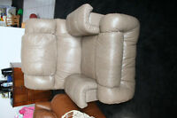 fauteuil en cuir 100%#1A condition,bercante,pivotante inclinable