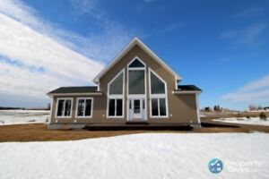 Custom built 3 bed/2 bath home on 80 ac with a river view