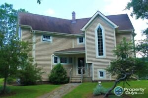 Waterfront gem on 3.9 acres with 3 bed/2.5 bath
